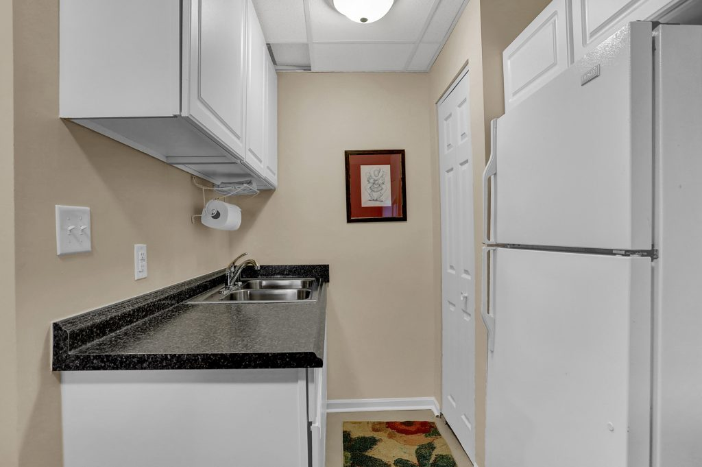 Kitchenette in family room is perfect for dock refreshments.