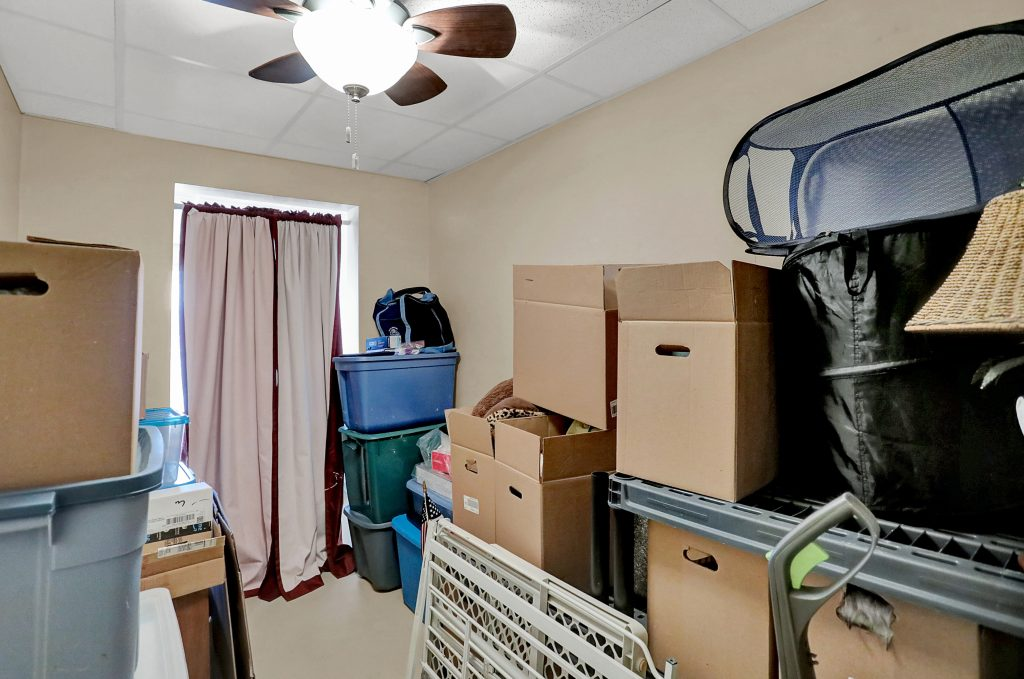 This room could be a guest bunk room, but currently used for storage.